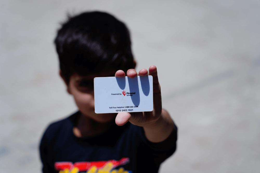 child-holding-sarvajal-card