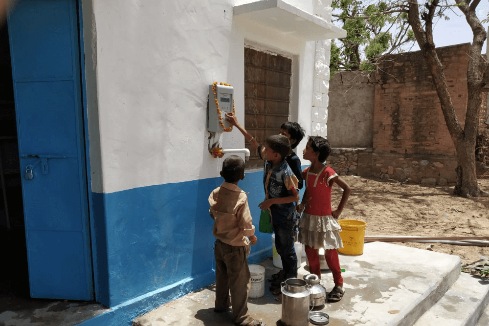 children-filling-water-from-atm