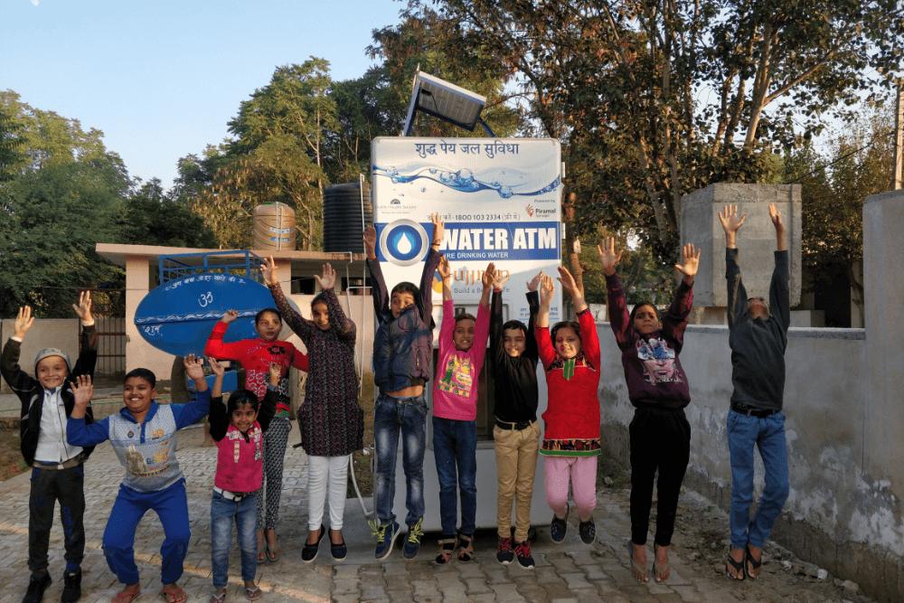 happy-children-with-ehs-water-atm