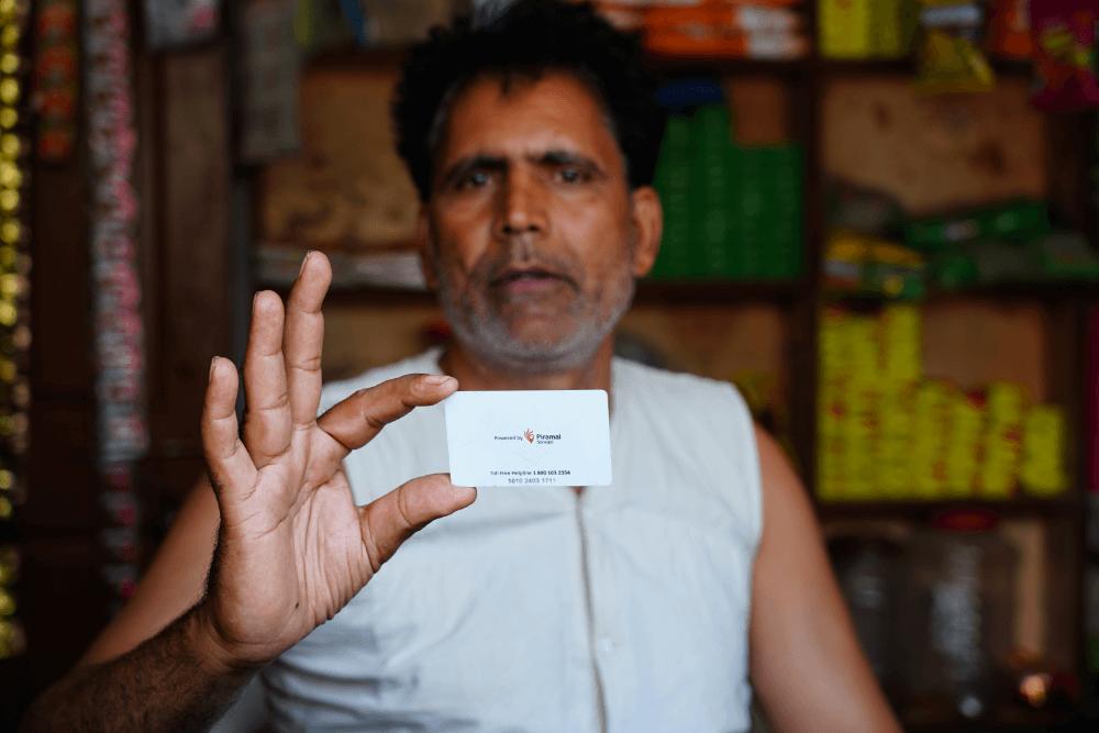 man-holding-sarvajal-card