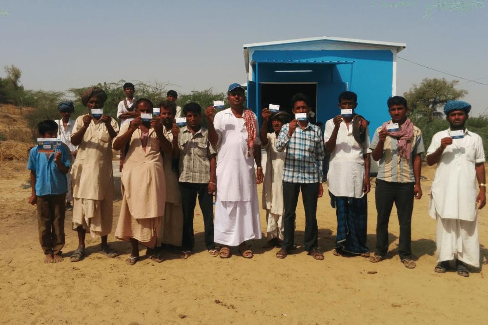 people-holding-sarvajal-card