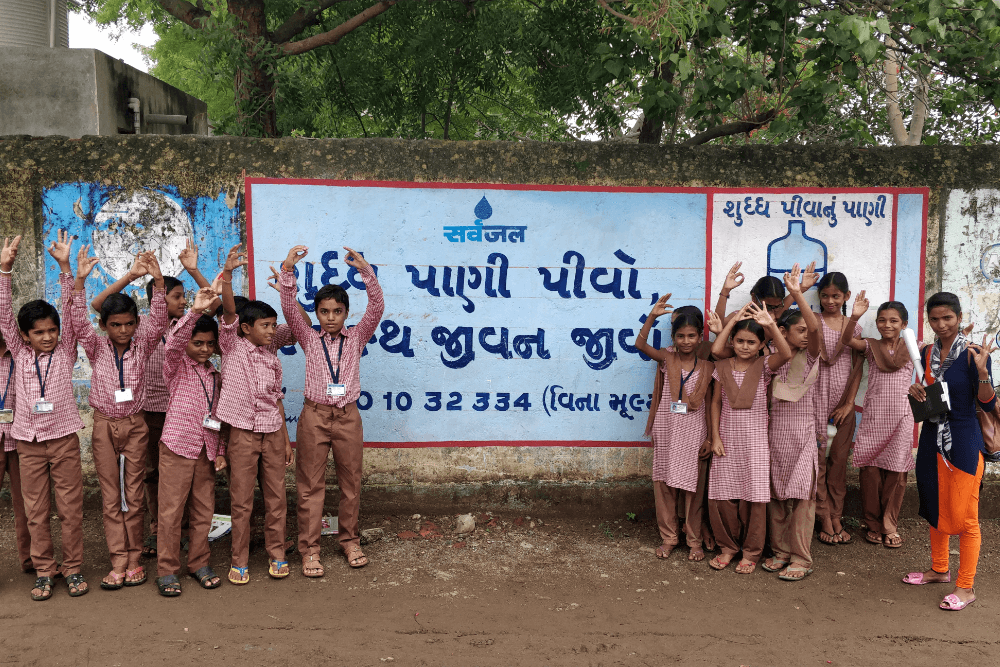 students-with-sarvajal-wall-ad