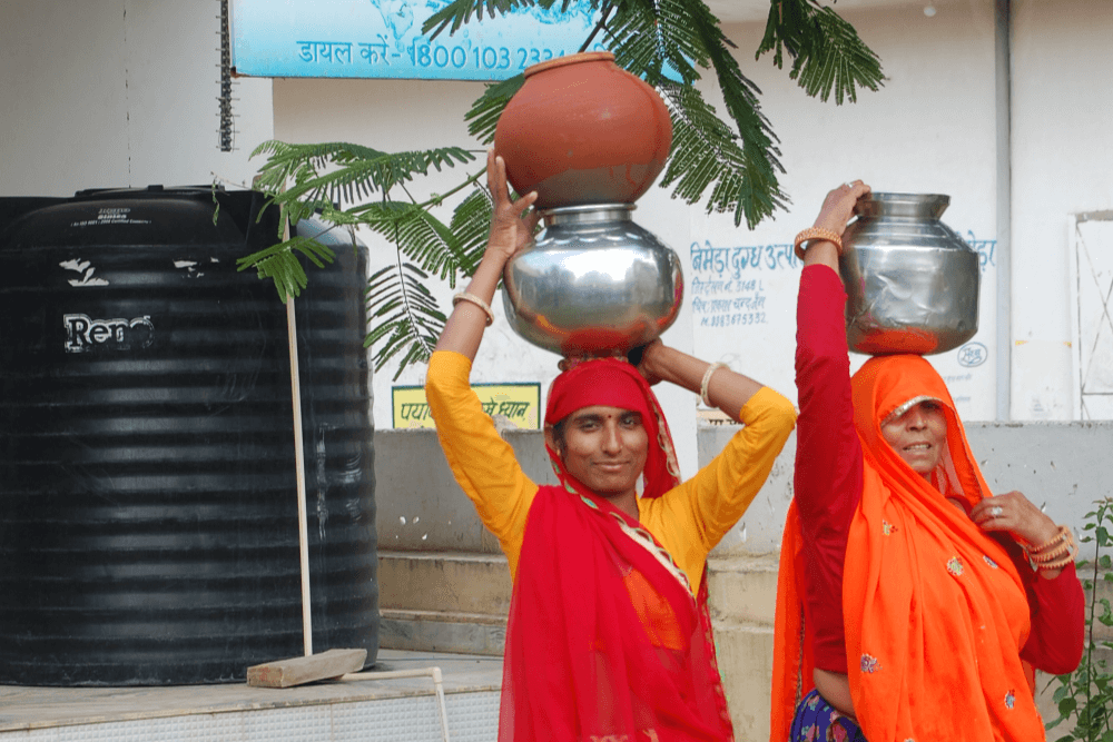 village-woman-happy-with-ehs-water