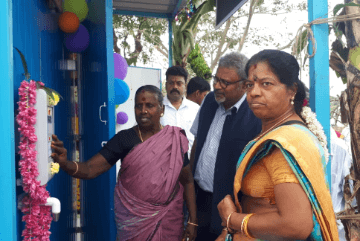 village-women-opening-water-atm