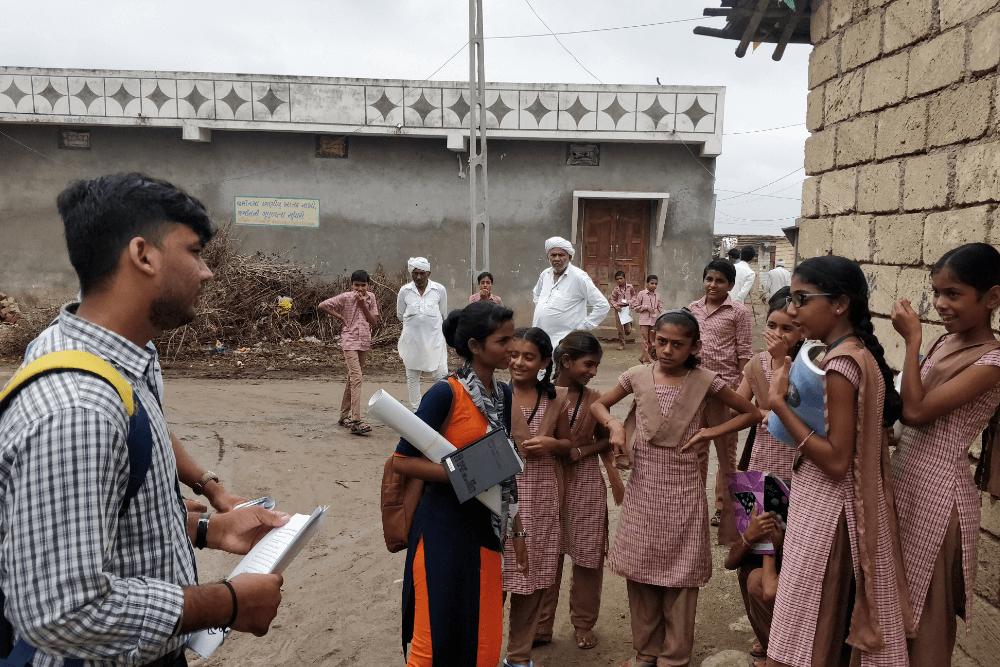 volunteer-discussing-with-school-girls