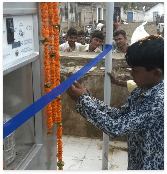water-atm-inauguration-by-child