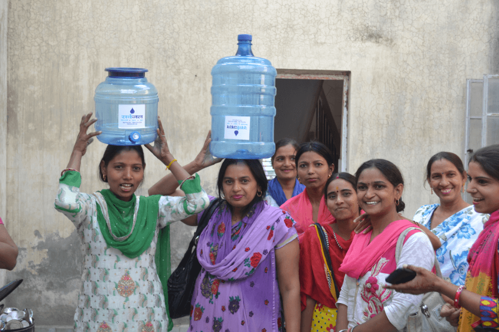 women-with-safe-water-jug