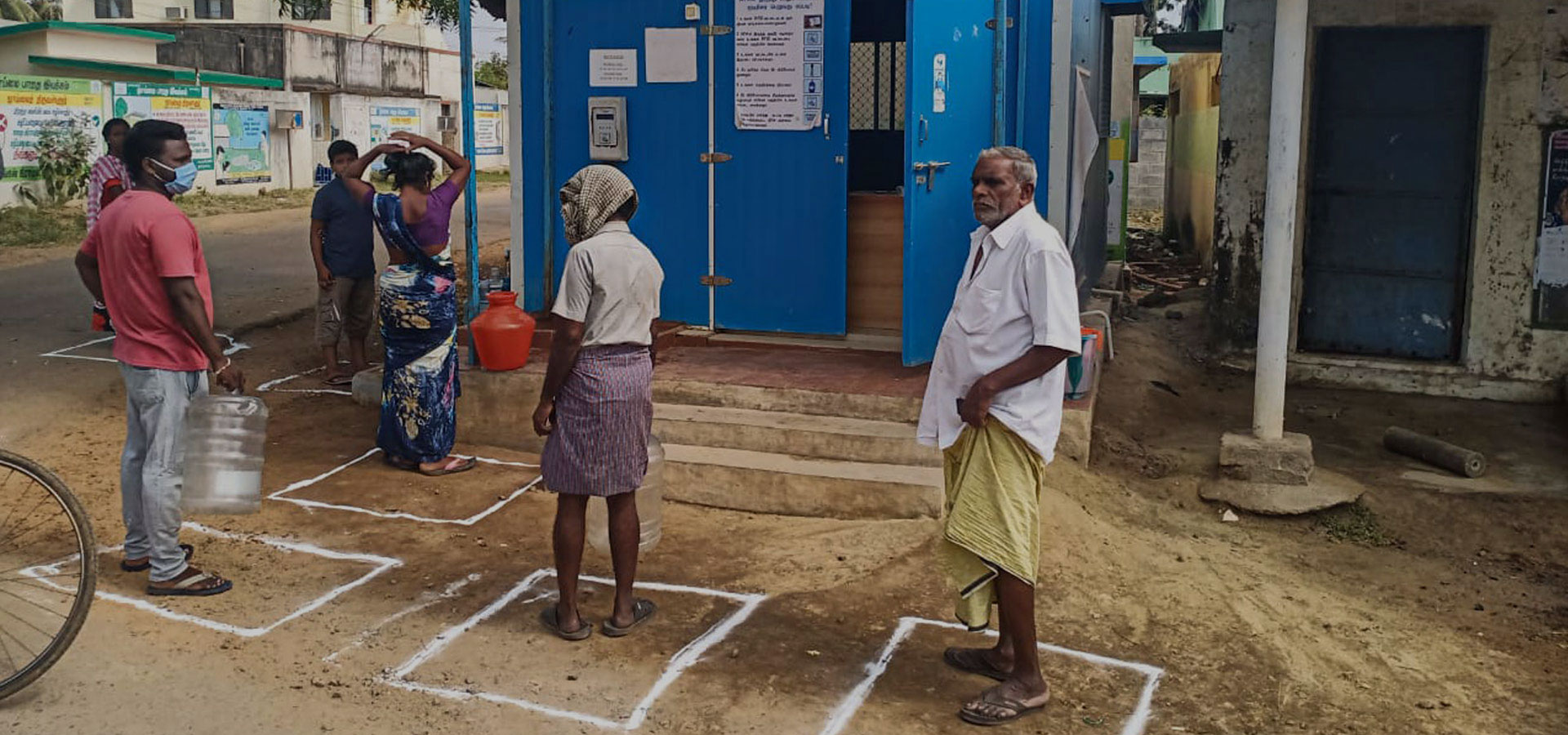 In COVID 19 - maintaining Social Distancing while standing in queue for filling water from Piramal Sarvajal water atm